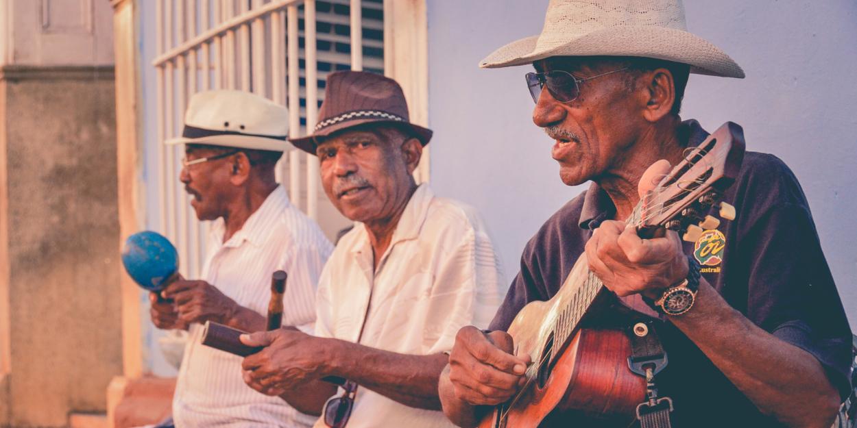 Three elderly men playing musical instruments in Nicoya