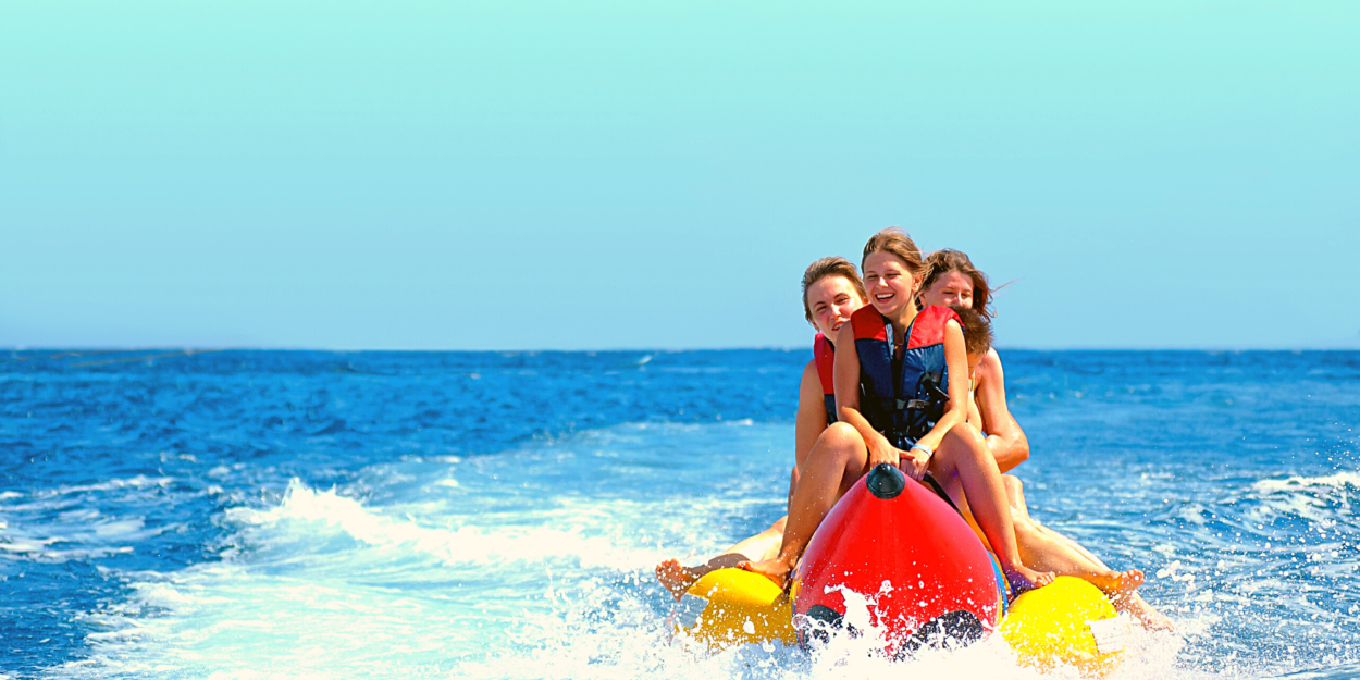 Kids riding a banana boat on the ocean in Costa Rica