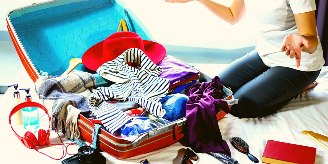 Clothing and items spilling out of a suitcase
