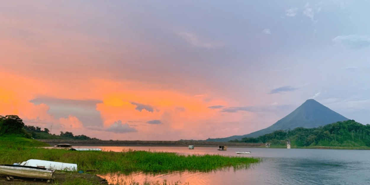 A view of Arenal Volcano from the lake at sunset