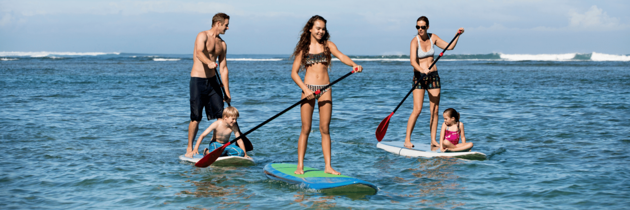 A family stand up paddling on the ocean in Costa Rica